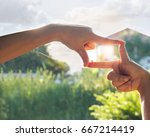 hands symbol with house in... | Shutterstock . vector #667214419