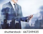 businessman using cellphone on... | Shutterstock . vector #667249435