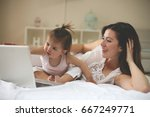 mother and her little baby at... | Shutterstock . vector #667249771