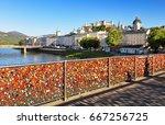 lovers padlocks on a bridge... | Shutterstock . vector #667256725