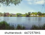 park with a lake in the center... | Shutterstock . vector #667257841
