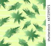 palm leaves seamless pattern.... | Shutterstock .eps vector #667259371