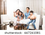 indian young family of 4... | Shutterstock . vector #667261081