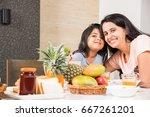 an attractive happy  smiling... | Shutterstock . vector #667261201