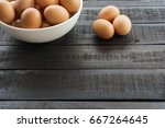 chicken egg in white bowl and 3 ... | Shutterstock . vector #667264645