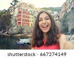 smiling girl taking selfie... | Shutterstock . vector #667274149