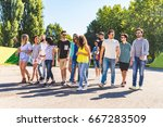 large group of friends walking... | Shutterstock . vector #667283509