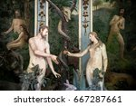 Small photo of Sacro Monte di Varallo, Piedmont, Italy, June 02 2017 - biblical characters scene representation of Adam and Eve in the Eden