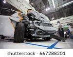 wrecked car after a crash test. | Shutterstock . vector #667288201