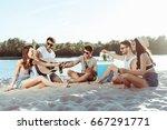 happy young friends taking beer ... | Shutterstock . vector #667291771