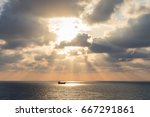 Sunset Ship In The Sea