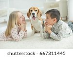 child with dog | Shutterstock . vector #667311445