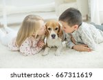 child with dog | Shutterstock . vector #667311619