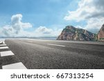 Asphalt Road And Mountain Unde...