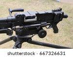 "Small photo of Close up of an L7A2 GPMG ""GIMPY"" General Purpose Machine Gun mounted on tripod"