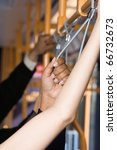 hands of people holding straps... | Shutterstock . vector #66732673