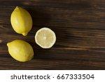 full and half of lemon on brown ... | Shutterstock . vector #667333504