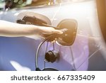 electric vehicle charging... | Shutterstock . vector #667335409