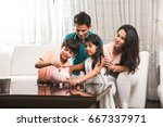 happy young indian couple... | Shutterstock . vector #667337971