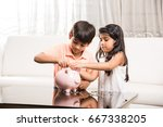 indian small kids with piggy... | Shutterstock . vector #667338205