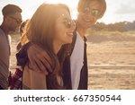 group of happy friends walking... | Shutterstock . vector #667350544
