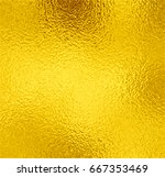 gold foil texture background.... | Shutterstock .eps vector #667353469