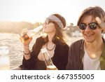 happy friends partying on the... | Shutterstock . vector #667355005
