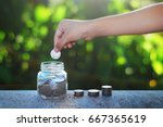 a child's hand holding a coin... | Shutterstock . vector #667365619