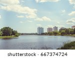 park with a lake in the center...   Shutterstock . vector #667374724