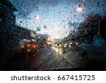 drizzle on the windshield in... | Shutterstock . vector #667415725