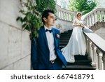 very happy wedding couple at... | Shutterstock . vector #667418791