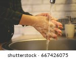 close up of two hands getting... | Shutterstock . vector #667426075