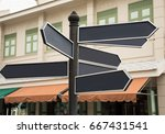 many blank direction road sign... | Shutterstock . vector #667431541