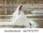 bride in a wedding dress and... | Shutterstock . vector #667472797
