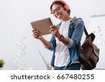 happy delighted student holding ... | Shutterstock . vector #667480255