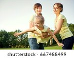happy family in the park. | Shutterstock . vector #667488499