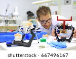 dental technician checks his... | Shutterstock . vector #667496167