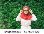 portrait of happy young muslim... | Shutterstock . vector #667507429