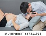 pregnant woman and husband are... | Shutterstock . vector #667511995