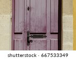 red shabby french style door at ... | Shutterstock . vector #667533349