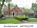 red brick house with stone...   Shutterstock . vector #667541239