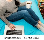 woman sitting in bed with a cup ... | Shutterstock . vector #667558561