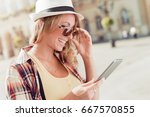 happy young woman using a...   Shutterstock . vector #667570855