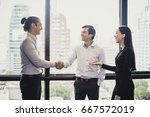 Small photo of Businesswoman introduce businessman for working at office, Portrait business concept, 20-30 year old, vintage tone.
