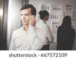 businessman using smartphone... | Shutterstock . vector #667572109