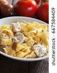 Small photo of Italian chicken alfredo, pappardelle pasta in cream and cheese sauce