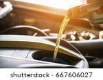 hand mechanic in repairing car... | Shutterstock . vector #667606027