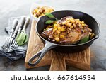 sauteed pork chops with... | Shutterstock . vector #667614934