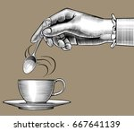 woman's hand with a coffee cup... | Shutterstock .eps vector #667641139
