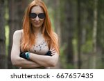 Red Haired Girl With Glasses...